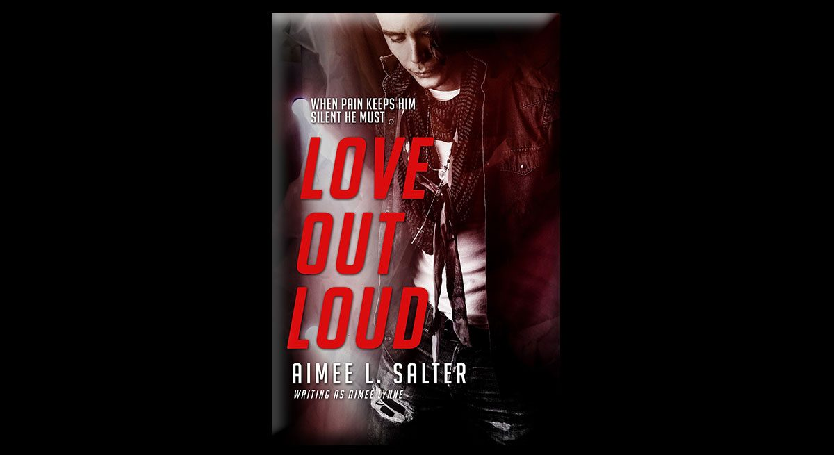 This is the cover of Aimee L. Salter's book, Love Out Loud. It shows a young main with pursed lips, a white t-shirt, and ripped jeans, gazing down.