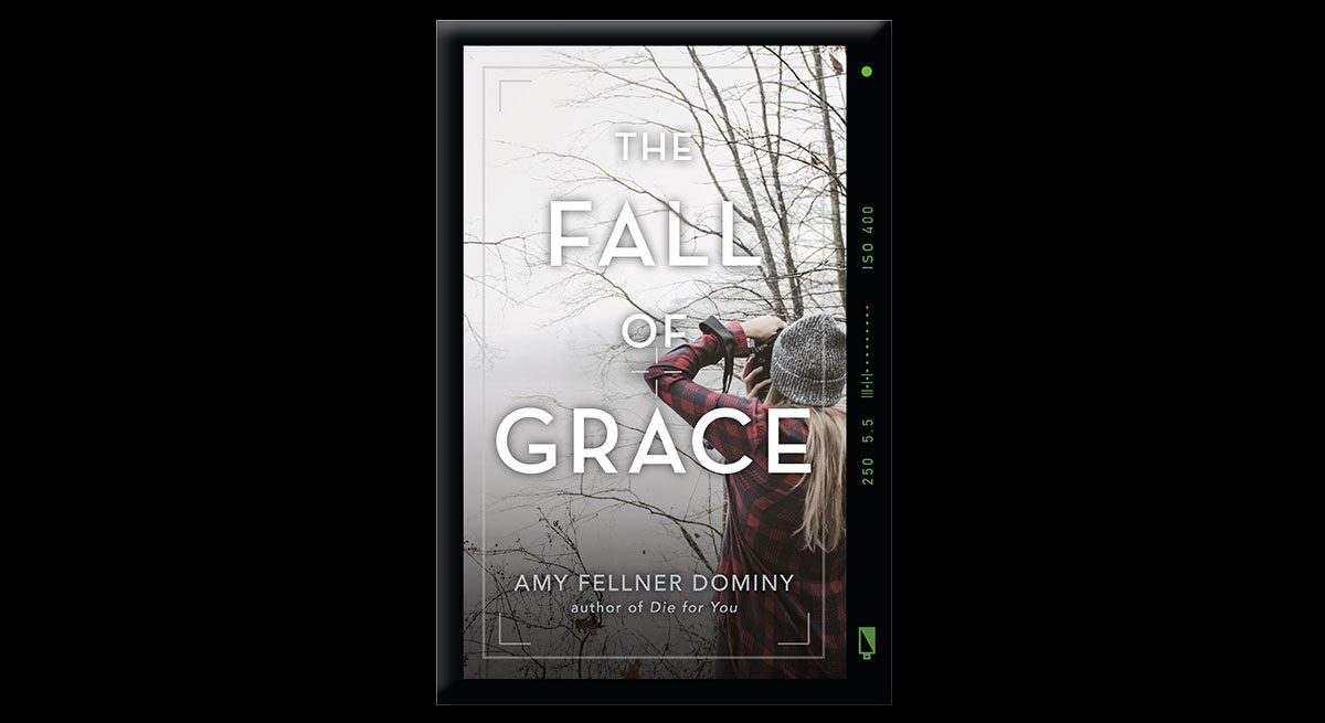 """This is the book cover for Amy Fellner Dominy's """"The Fall of Grace."""" the book cover, which features a girl with long hair, plaid jacket and hat, looking up at a winter sky through binoculars."""