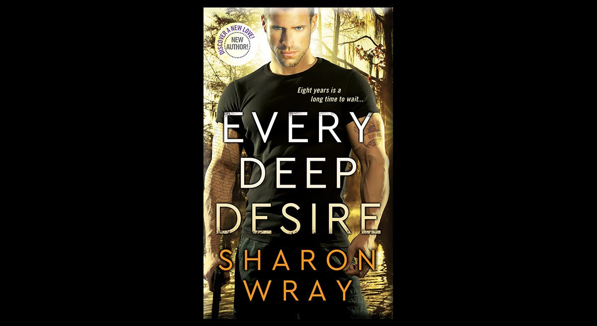 """This is the book cover of Shannon Wray's """"Every Deep Desire."""" It features an attractive man in a black shirt, holding a gun that is pointed at the ground."""