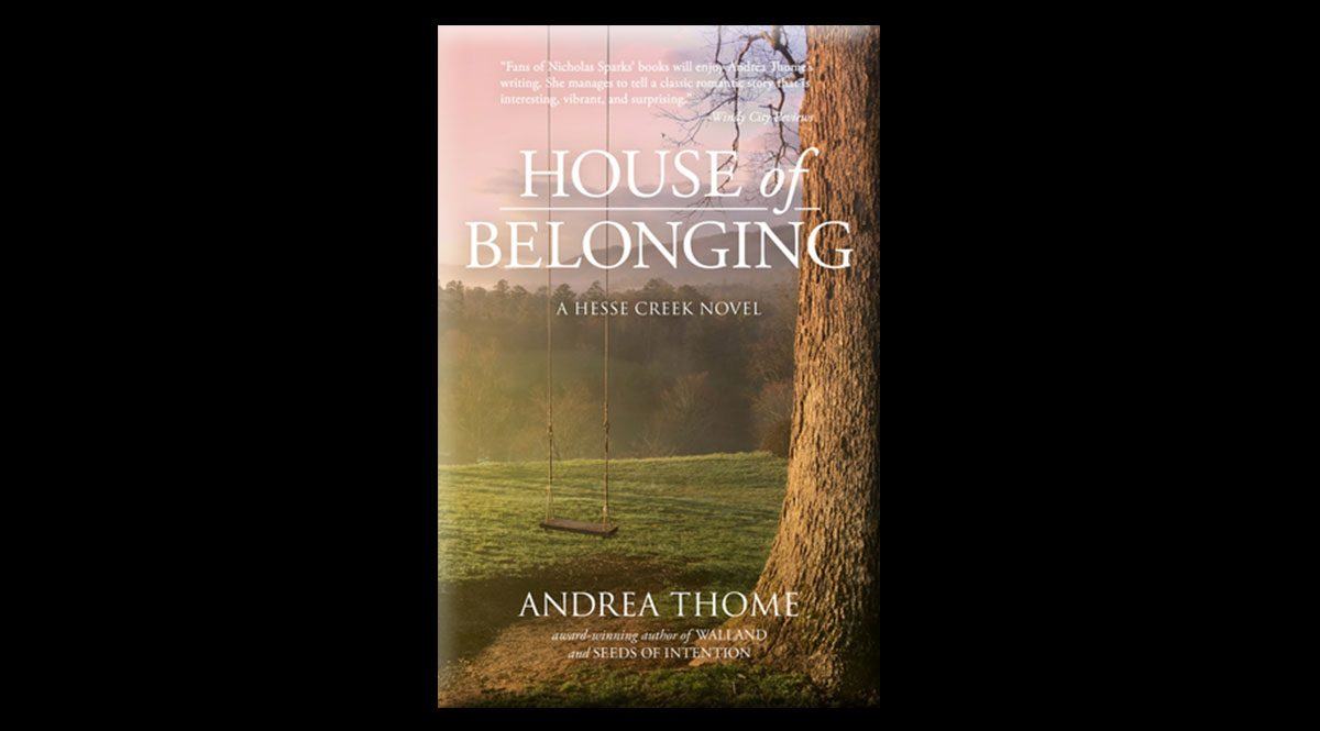 This is the cover of Andrea Thome's novel, House of Belonging. It features a hazy background with trees, and a tree in the foreground, from which an empty rope swing hangs.